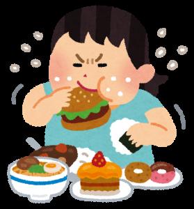 食べ物をやけ食いする女性